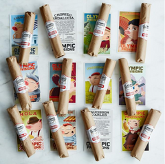 Twelve wrapped cheese products with labels to identify their descriptions