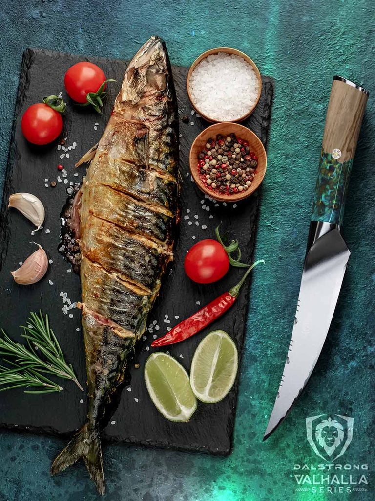 A cooked and seasoned fish next to a fillet knife with a colorful handle