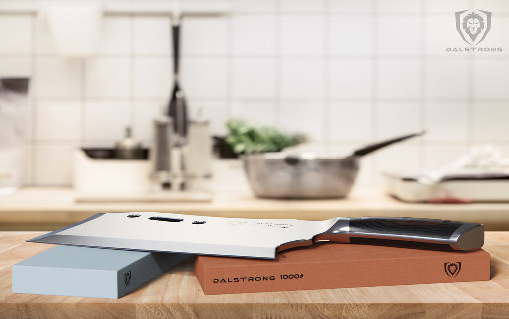 Dalstrong Gladiator Series Cleaver rests on a whetstone in a clean kitchen