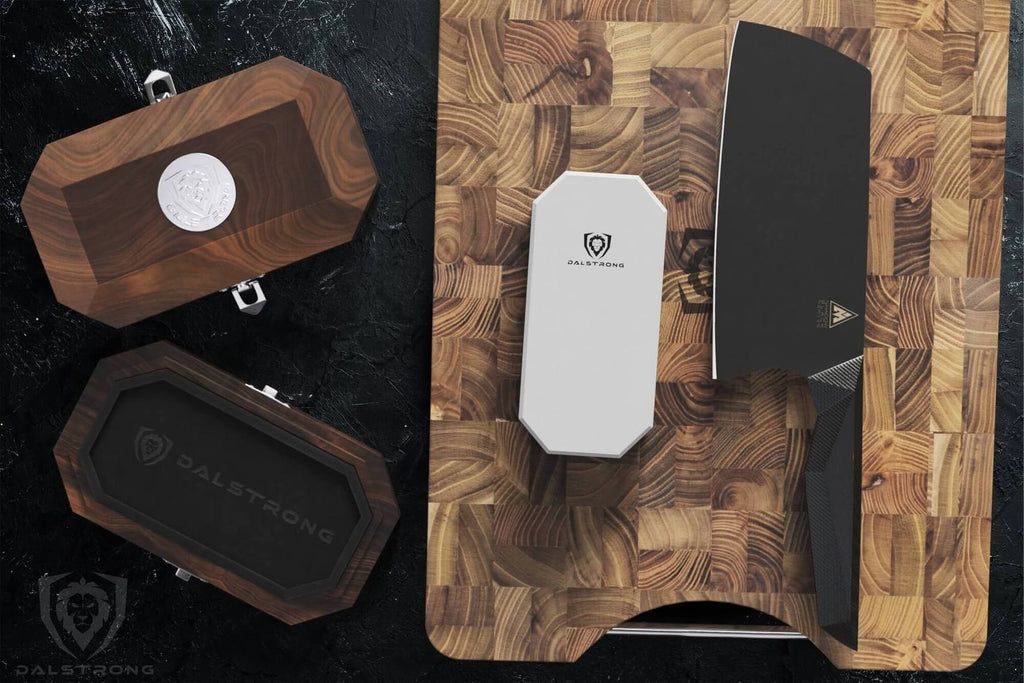 An oak box next to a cutting board with a portable whetstone and a black cleaver resting on it