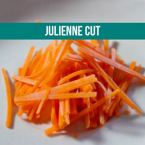 Julienned carrots on plain white surface