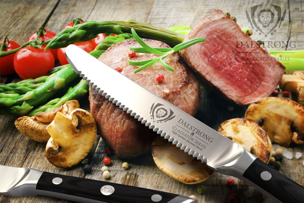 Gladiator Series Steak knife laying against a pile of chopped medium rare steak and grilled vegetables