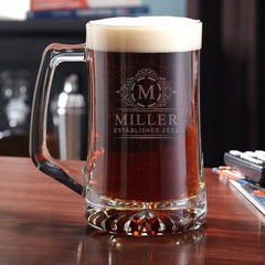A tall beer mug filled to the rim with brown ale