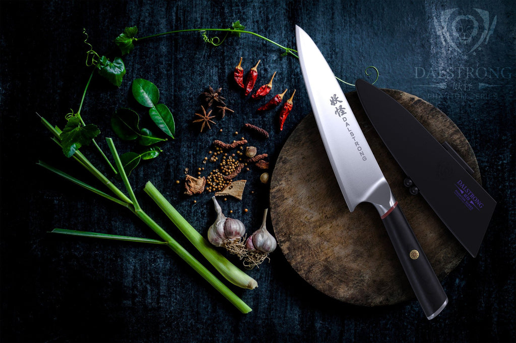 Phantom Series Chef Knife Resting On A Circular Wooden Cutting Board Surrounded by chopped vegetables on a dark wooden table