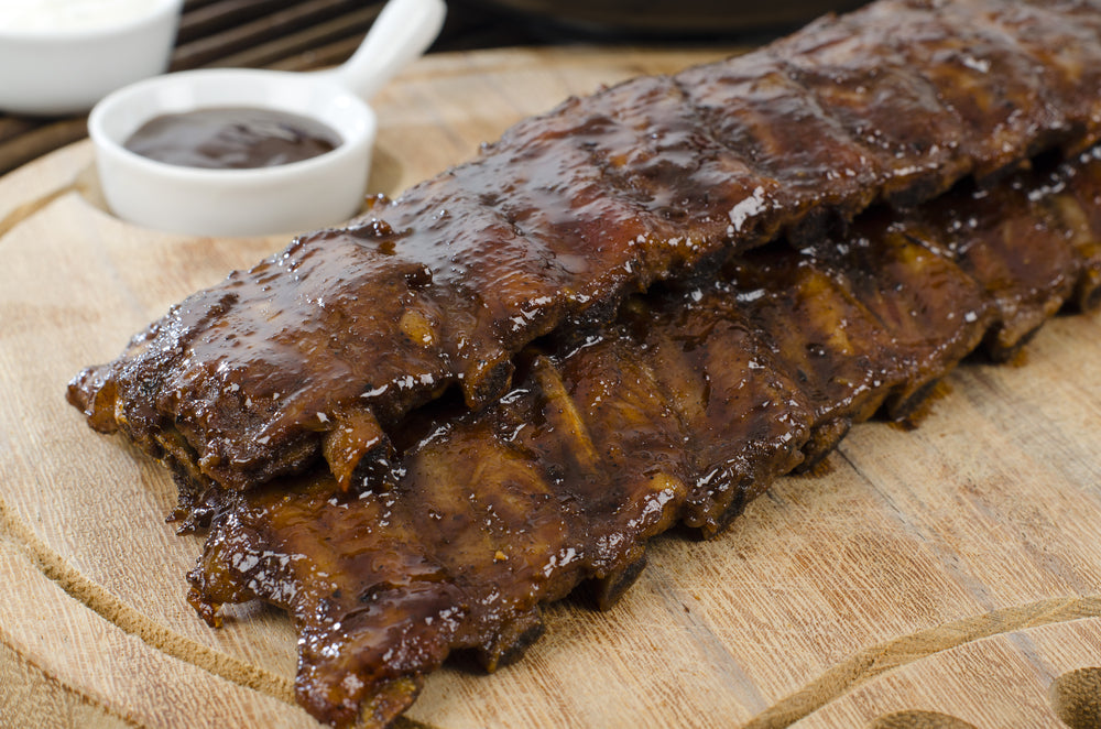 BBQ Ribs - Marinated pork ribs with barbeque sauce dip.