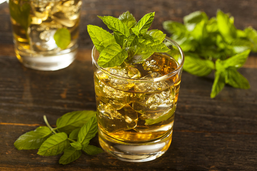 Homemade Gourmet Fresh Mint Julep Alcoholic Cocktail on wooden table