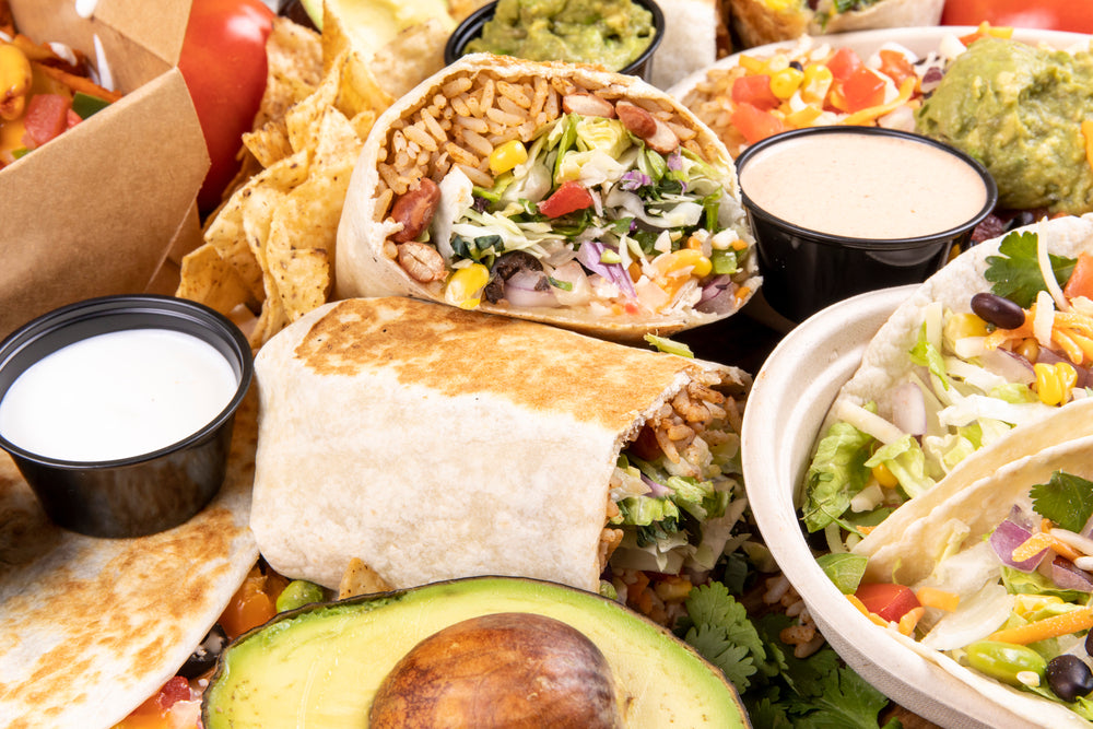 A selection of Mexican fast food including burritos and tacos
