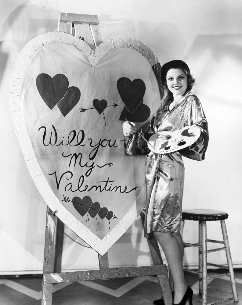 Classic black and white image of woman painting a valentine's day gift for her partner