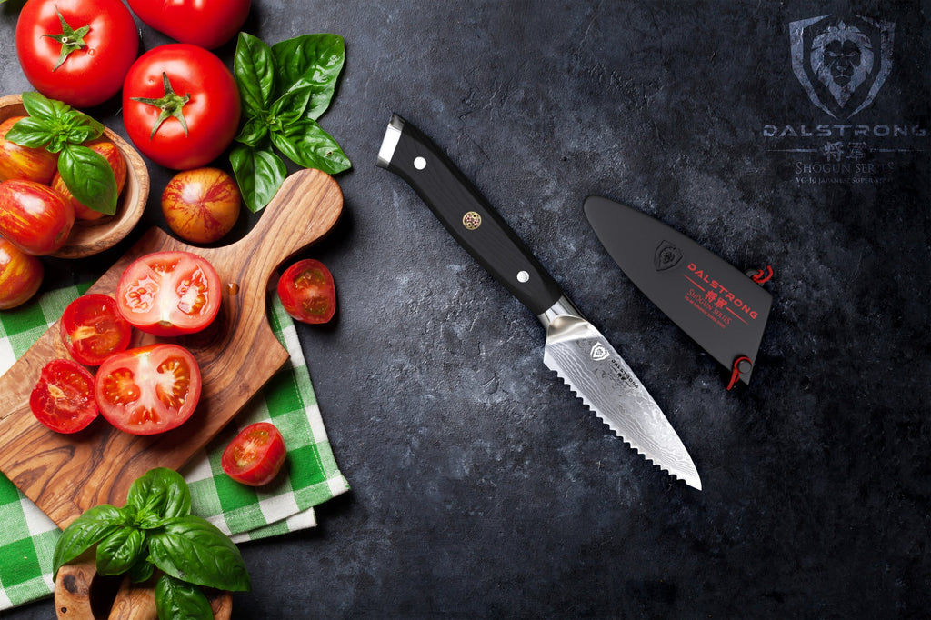 Serrated paring knife next to a cutting board filled with vegetables