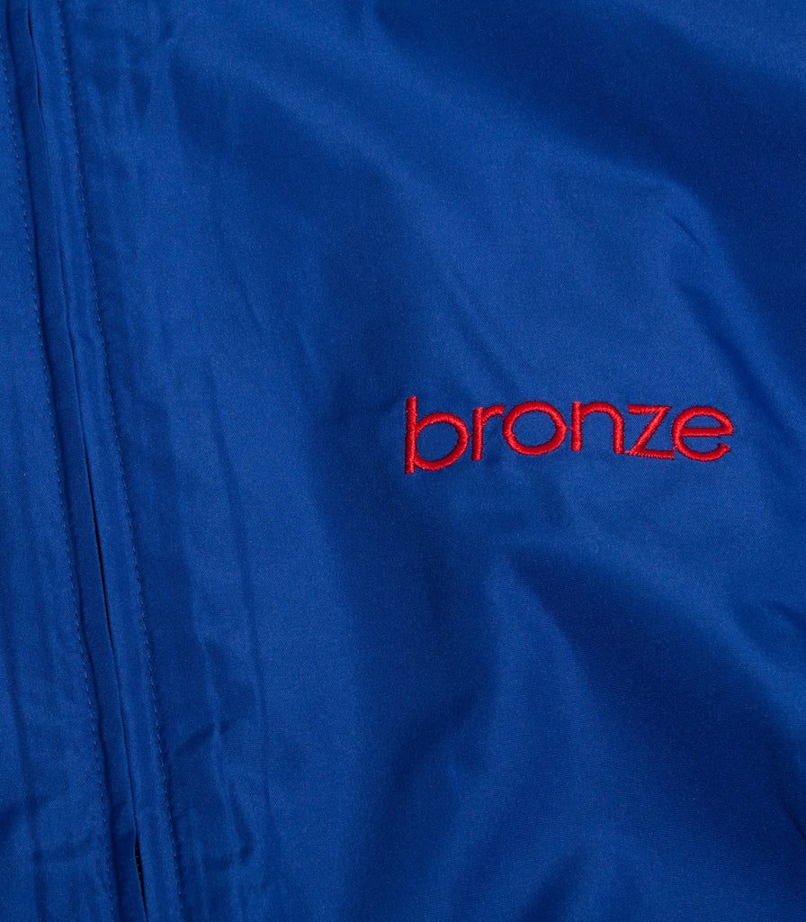 Bronze 56K Embroidered Windbreaker