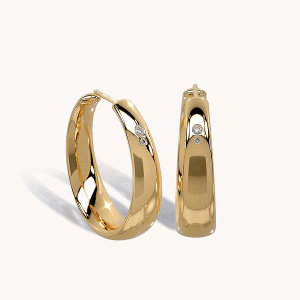 Duet Hoop Earrings representing all the Hoops women have jumped through and how we've supported each other through it all. Meaningful gifts for women. Anniversary gift. Timeless jewelry. Gold hoops women empowerment