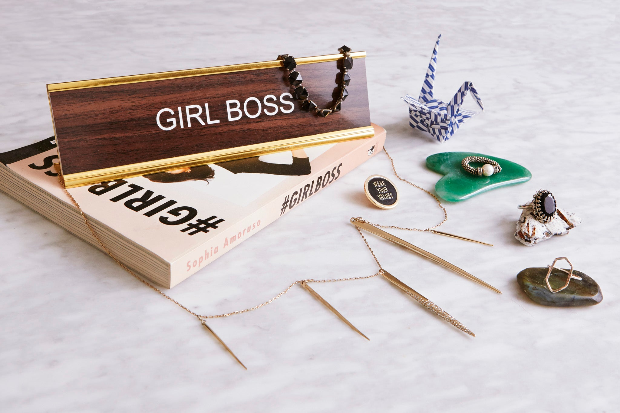 girl boss nameplate and assorted jewelry from britt bergmeister for shiffon co.
