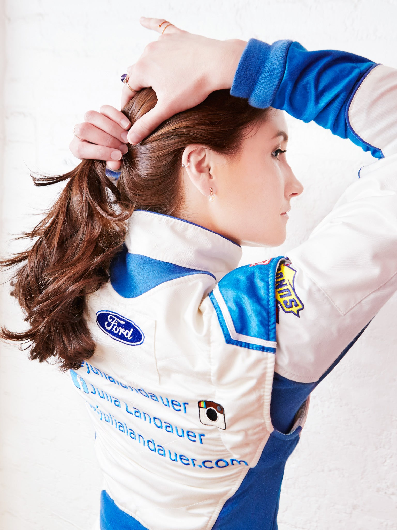 Julia landauer in racing uniform