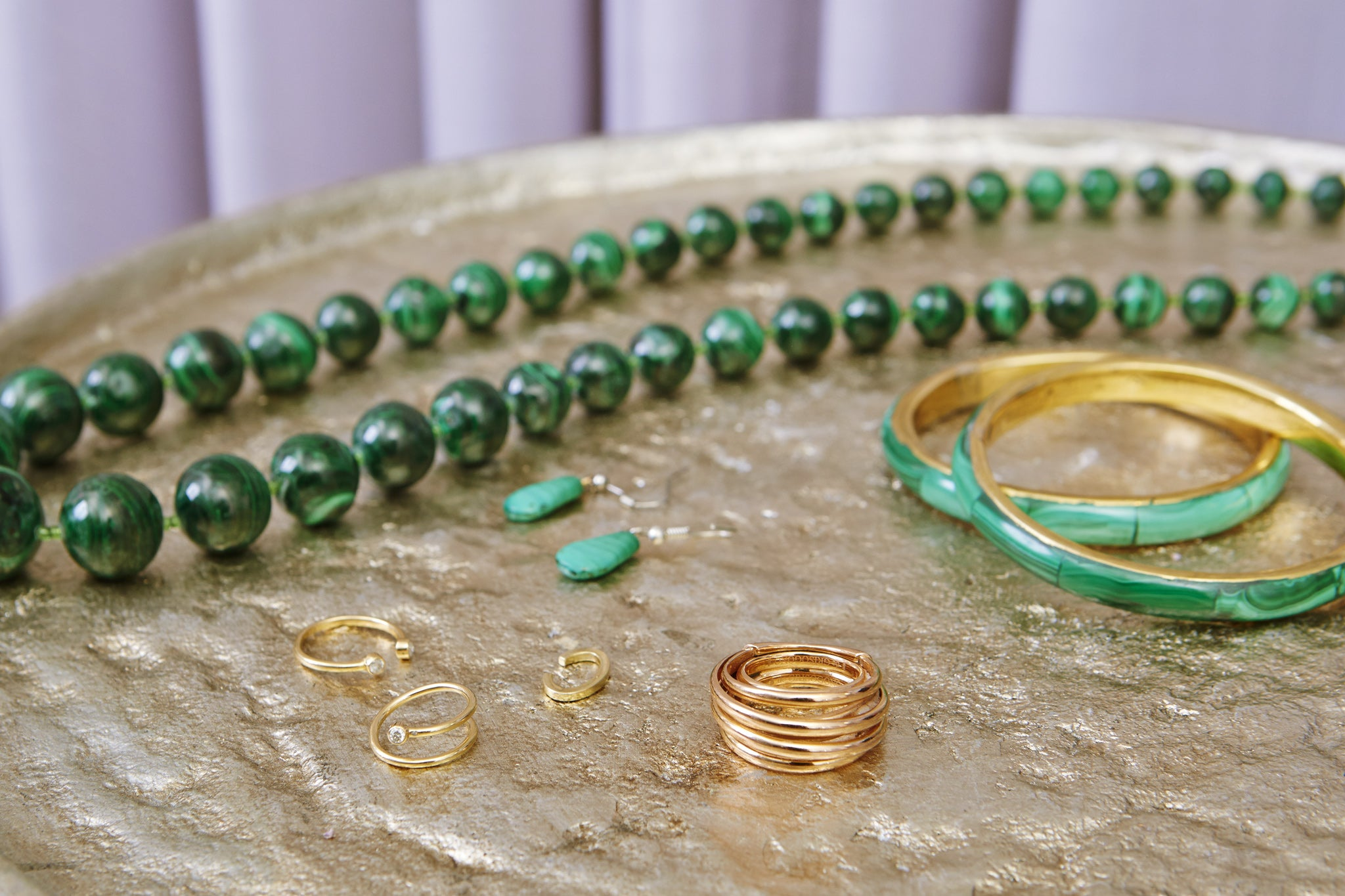 green malachite jewelry from the democratic republic of the congo and shiffon pinky ring on gold table