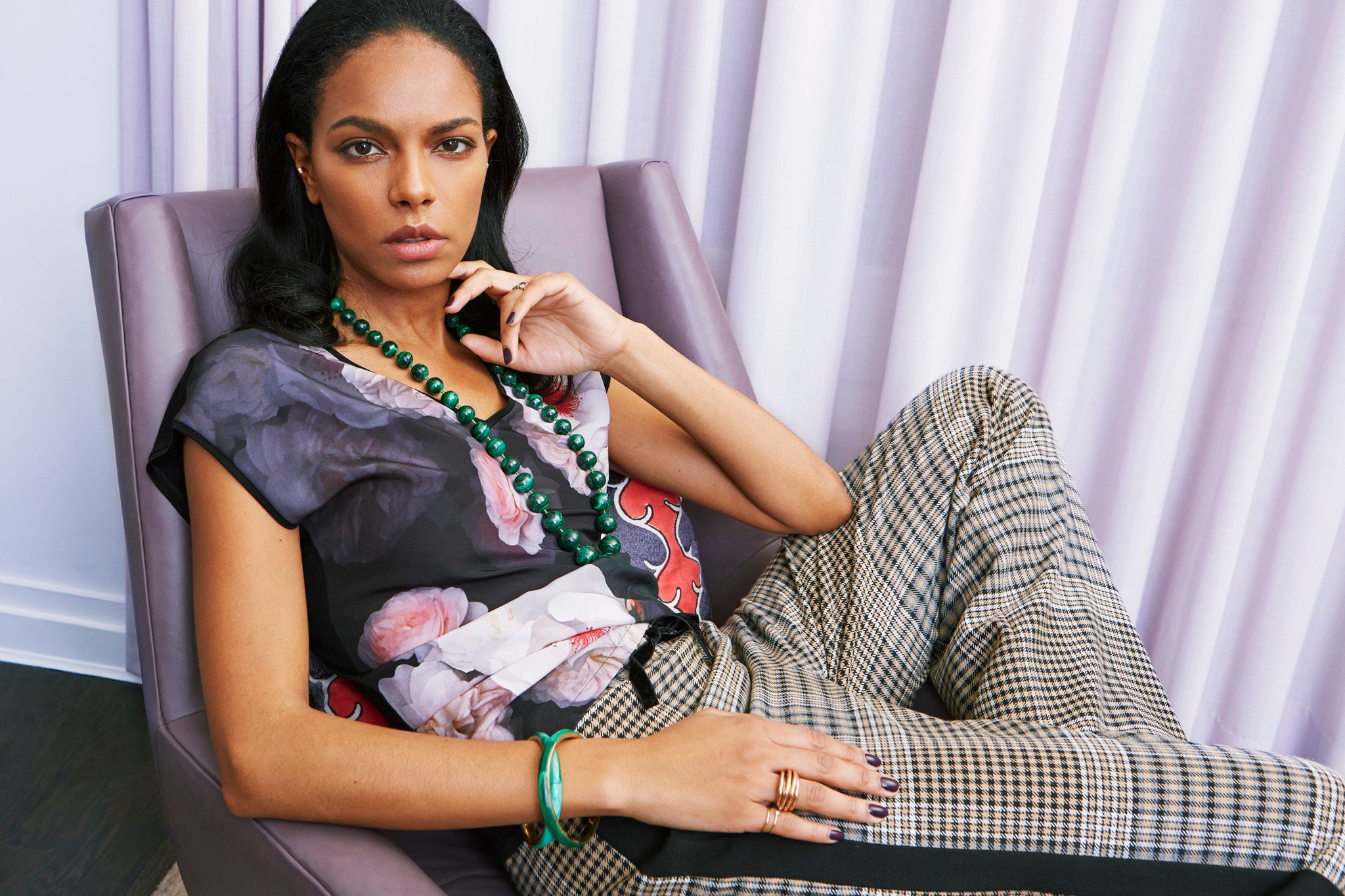 international model noella coursaris musunka reclines on a chair for shiffon what's in my jewelry box interview