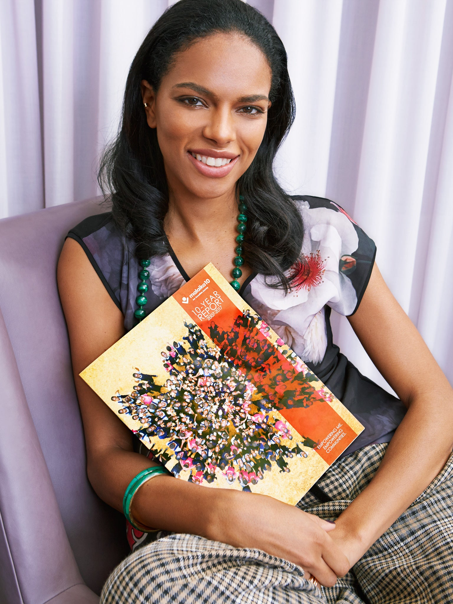 model noella coursaris musunka holding malaika brochure for shiffon what's in my jewelry box