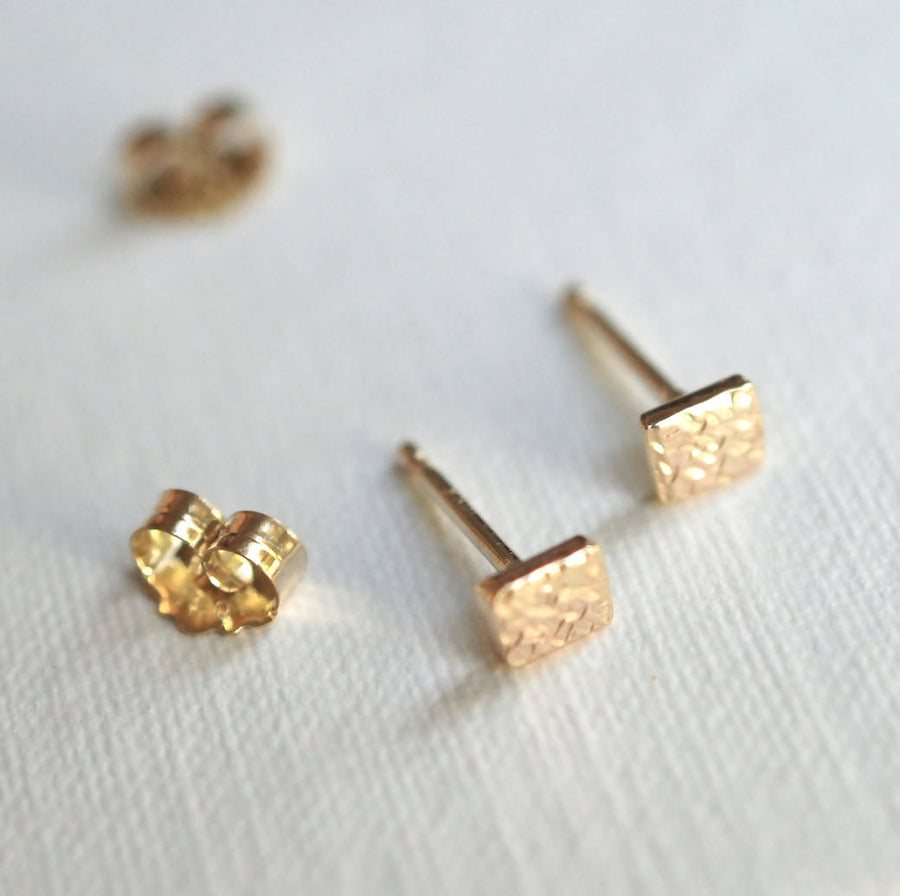 Tiny square gold studs