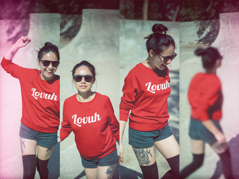 model wearing red sweatshirt printed with lovuh in white script