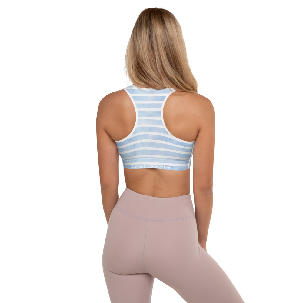 back view of fit model wearing pastel blue striped sports bra