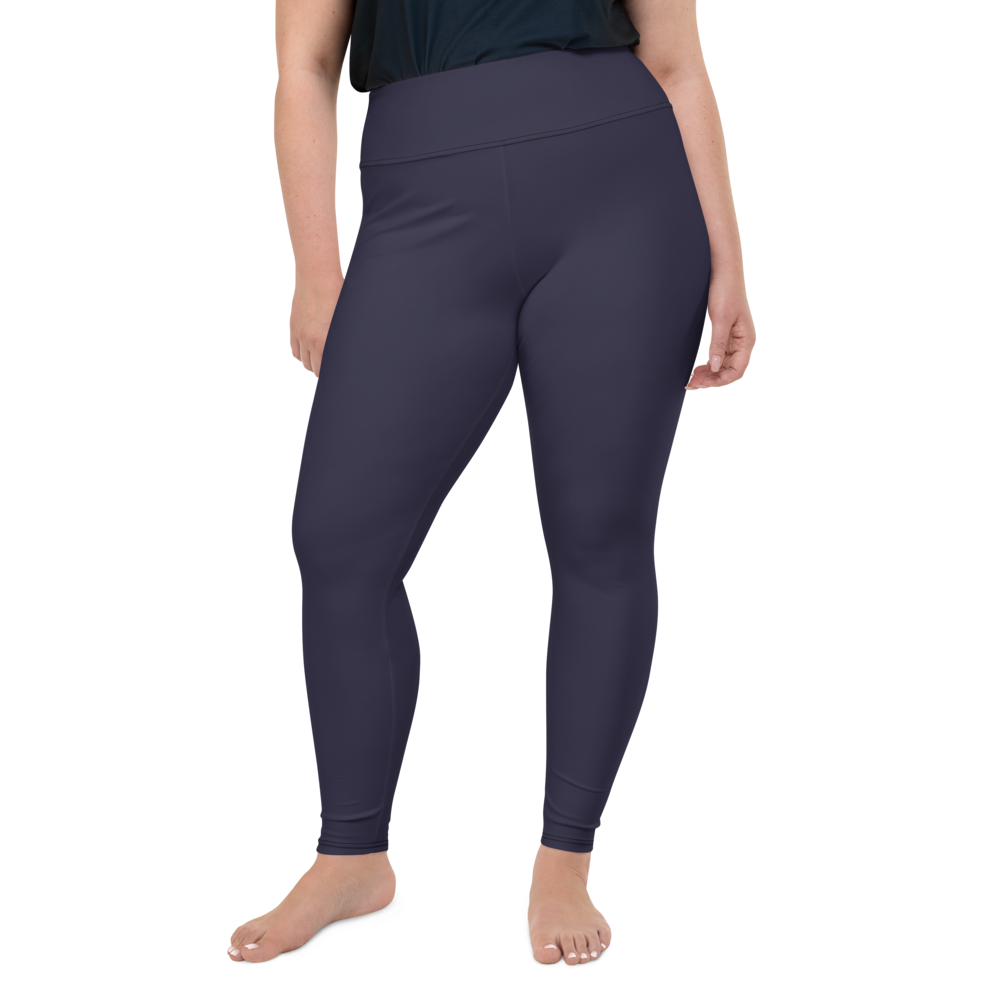 plus size fit model wearing navy blue high-waisted yoga pants leggings