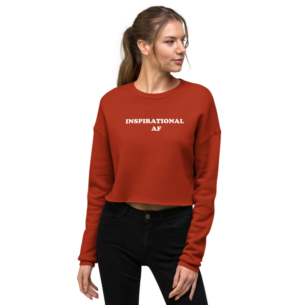 fit model wearing a red crop raw hem sweatshirt with Inspirational AF printed across the front in white font