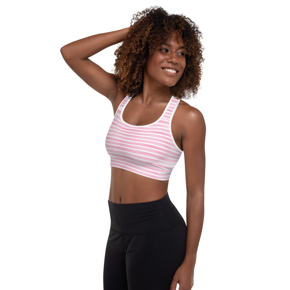 african american fit model wearing pastel pink stripe sports bra