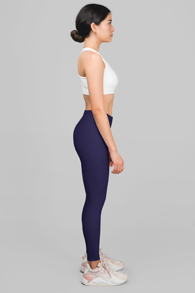 brunette fit model wearing solid navy blue print leggings yoga pants