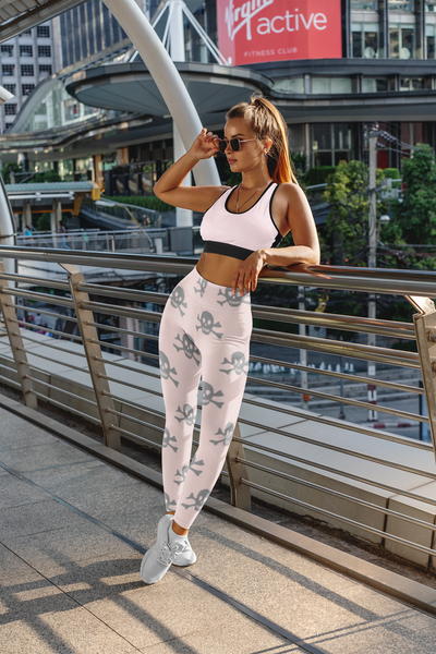 Fitness Model wearing grey skull & crossbones printed on pink yoga pants leggings