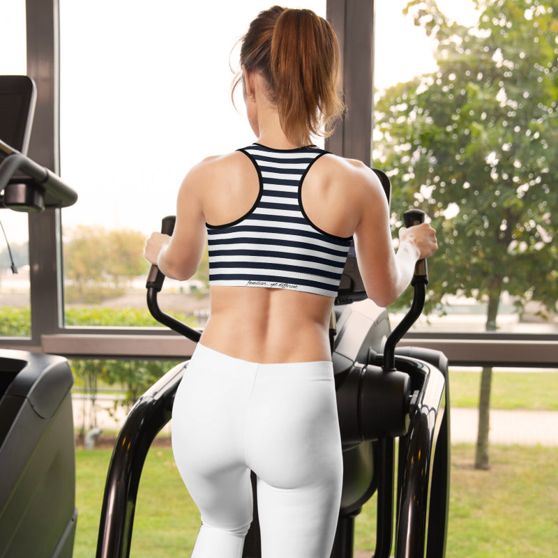 back view of fit model wearing black & white nautical stripes sports bra at the gym