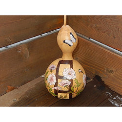 Artist has designed and hand painted this gourd