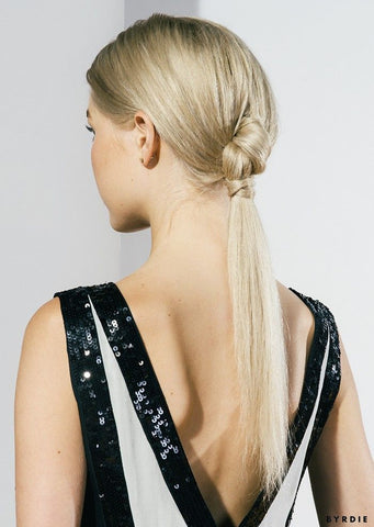 The knotted ponytail is a classy, easy hairstyle for women who are always on the go.