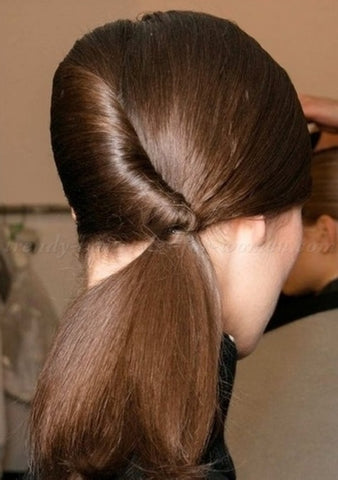 The reversed French twist pony is another one of the easy hairstyles for work on our list.