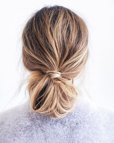 Low chignon stylish updo using hair extensions