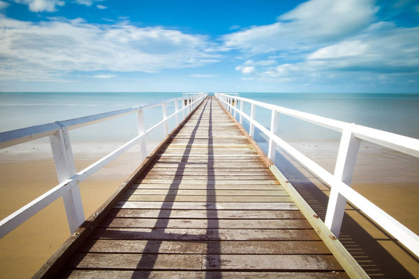 A beautiful pier on a sunny beach - something to look forward to one day