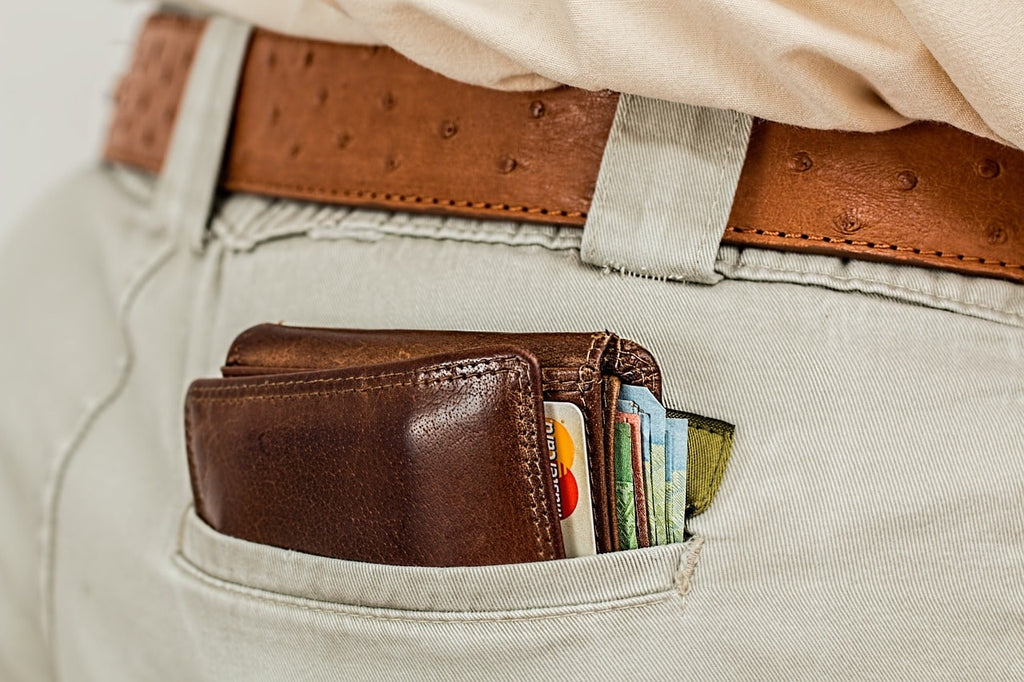Big bulging wallet in back of man's trousers