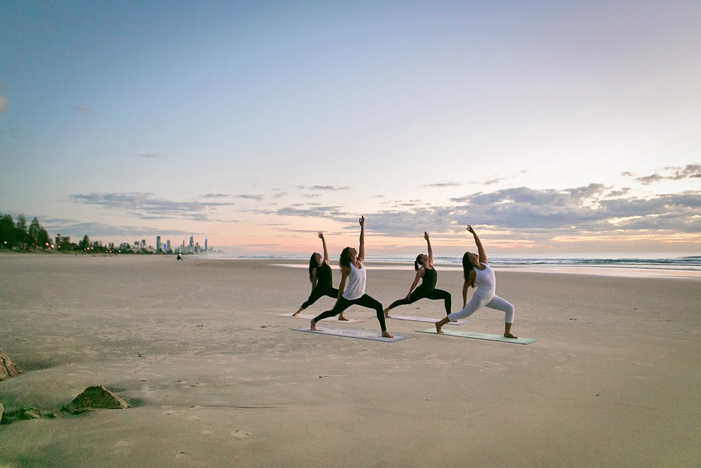 Sahaja Yoga mats, 4 yogis on a beach, gold coast
