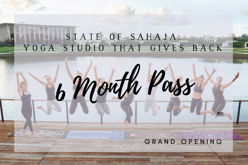 State of Sahaja yoga studio is a yoga studio that gives back on the gold coast, yogis on a yoga deck.