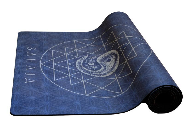 Sahaja yoga mat, yin yoga logo on blue background.