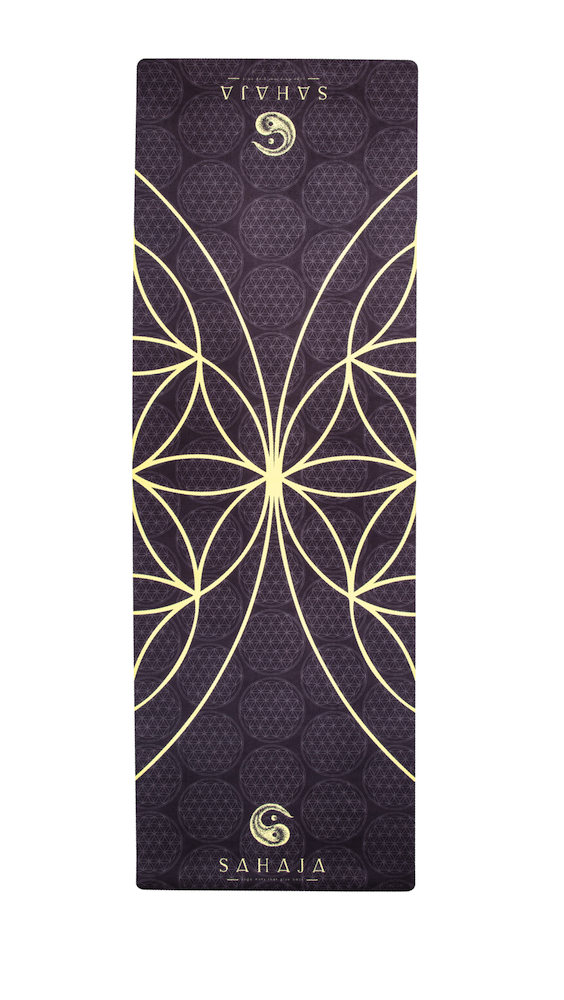 Sahaja Yoga Mats That Give Back. rolled out Yang travel yoga mat. Black with yellow flower of life, sacred geometry yoga mat that gives back with every purchase.