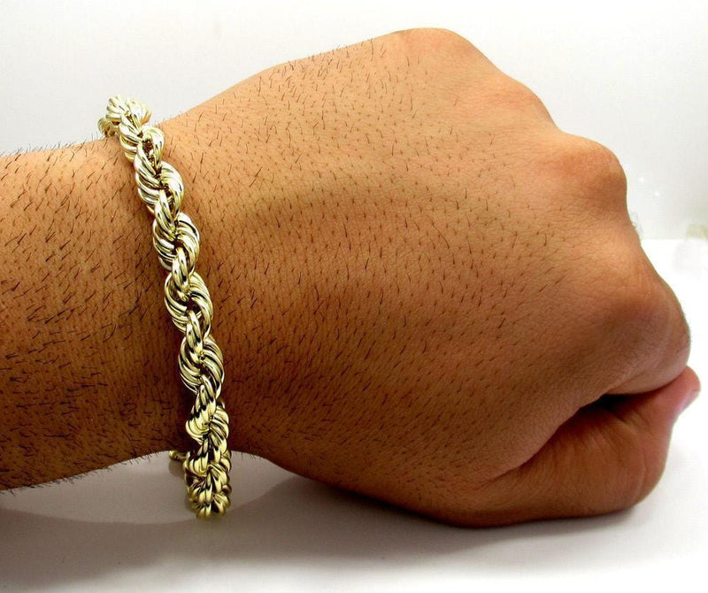 gold rope chain bracelet on hand