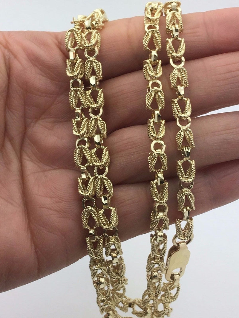 turkish gold chains on hand