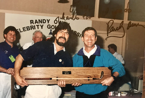 Country music star Randy Ownes receiving his Otey Crisman putter