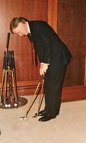Vice President Dan Quayle trying out an Otey Crisman putter