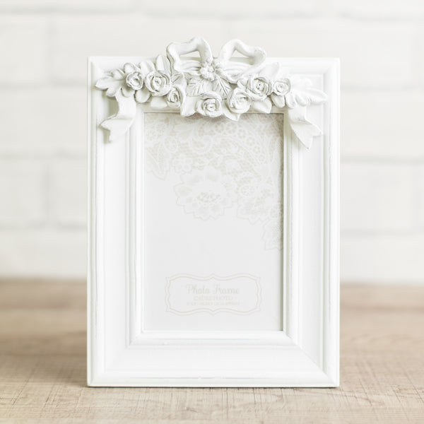 White photo frame with bow