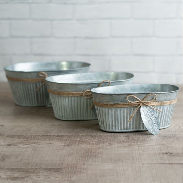 Zinc oval planters with tags