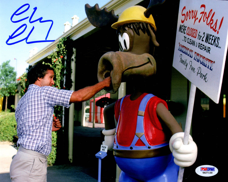 Chevy Chase Signed picture punching the moose - LuxeWest