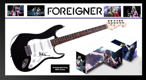 Foreigner' Signed Guitar in Framed Case