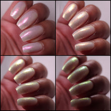 nail polish by crystal knockout, angel aura shock, sheer white with pink glow and iridescent flakes
