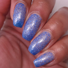 nail polish by crystal knockout, aventurine hit, a dark blue to light blue thermal with matte blue and white glitter