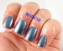 light blue metallic shimmer nail polish crystal knockout titanium fountain